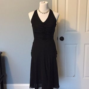 Classic black silk halter dress with rosettes.